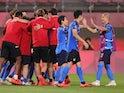 Japan players celebrate after winning the penalty shoot-out on July 31, 2021