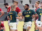 South Africa's Lukhanyo Am celebrates scoring their second try with Faf De Klerk against the Lions on July 31, 2021