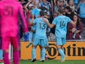 Minnesota United defender Chase Gasper (77) celebrates his goal with his team against the Portland Timbers in the second half at Allianz Field on July 24, 2021