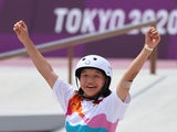 Momiji Nishiya celebrates winning skateboarding gold at the Tokyo Olympics on July 26, 2021