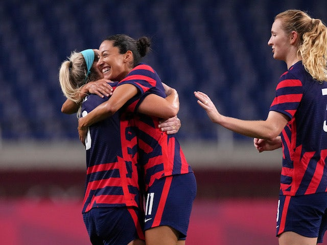 United States forward Christen Press (11) celebrates her goal against New Zealand with midfielder Julie Ertz (8) during the second half in group G play during the Tokyo 2020 Olympic Summer Games at Saitama Stadium on July 24, 2021