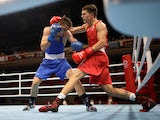 Aliaksandr Radzionau of Belarus in action against Pat McCormack of Britain at the Tokyo 2020 Olympics on July 27, 2021
