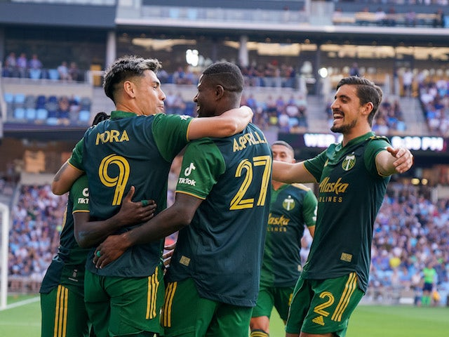 Portland Timbers forward Felipe Mora (9) celebrates his goal with forward Dairon Asprilla (27) against the Minnesota United in the first half at Allianz Field on July 24, 2021