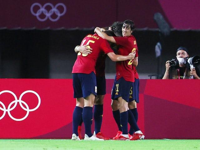 Rafa Mir of Spain celebrates scoring their fourth goal with teammates on July 31, 2021