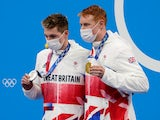 Tom Dean and Duncan Scott celebrate with their medals during the medals ceremony for the men's 200m freestyle during the Tokyo 2020 Olympic Summer Games