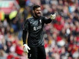 Liverpool's Alisson gives instructions to his teammates on August 8, 2021