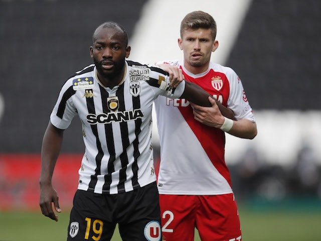 Angers' Stephane Bahoken in action with AS Monaco's Caio Henrique in Ligue 1 in April 2021