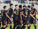 Atlanta United midfielder Marcelino Moreno (10) celebrates with teammates after scoring a goal against the Columbus Crew in the second half at Lower.com Stadium on August 7, 2021