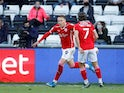 Barnsley's Cauley Woodrow celebrates scoring their first goal with Callum Brittain in May 2021