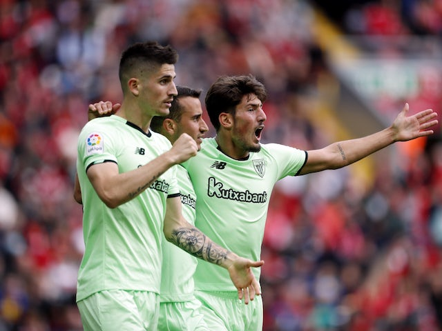 Athletic Bilbao's Alex Berenguer celebrates scoring his first goal with his teammates on August 8, 2021