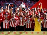 Brentford's Pontus Jansson lifts the trophy after winning Championship Play-Off Final pictured on May 29, 2021