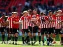 Brentford players celebrate after winning the Championship Play-Off Final pictured May 29, 2021