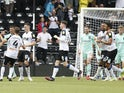 Derby County's Curtis Davies celebrates scoring their first goal with teammates on August 7, 2021