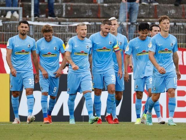 SC Freiburg's Jonathan Schmid celebrates scoring their first goal with teammates on August 8, 2021