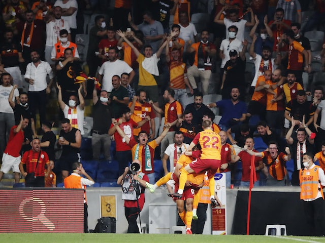 Galatasaray's Sacha Boey celebrates scoring their first goal with their fans on August 5, 2021