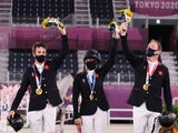 Great Britain's equestrian team celebrates winning Eventing gold at the Tokyo 2020 Olympics on August 2, 2021