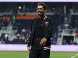 DC United head coach Hernan Losada smiles as he walks off the field after the against FC Cincinnati in the first half at TQL Stadium on July 31, 2021
