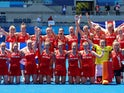 Players of Great Britain's women's team pose for a group photo after winning their match for bronze in hockey at the Tokyo Olympics