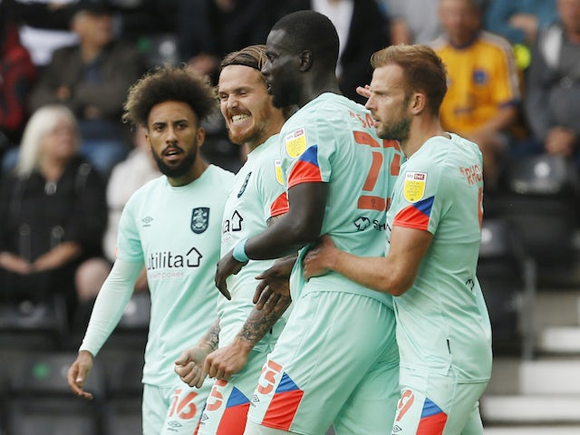 Huddersfield Town's Mouhamadou-Naby Sarr celebrates scoring their first goal with teammates on August 7, 2021