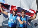 John Gimson of Britain and Anna Burnet of Britain celebrate winning silver after the race on August 3, 2021