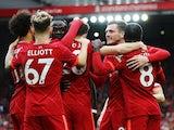 Liverpool's Diogo Jota celebrates scoring their first goal with teammates on August 8, 2021