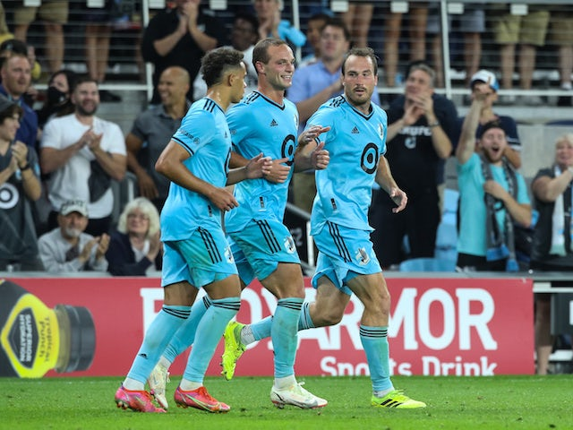 Minnesota United midfielder Hassani Dotson (31) and defenseman Chase Gasper (77) celebrate a goal after defenseman Brent Kallman (14) scored against the Houston Dynamo in the second half at Allianz Field on August 7 2021