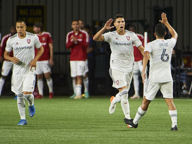 Real Salt Lake midfielder Damir Kreilach (8) celebrates with midfielder Pablo Ruiz (6) after scoring a goal against the Portland Timbers during the second half at Providence Park pictured on August 7, 2021