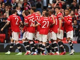 Manchester United players celebrate Harry Maguire's goal against Everton in a pre-season clash on August 7, 2021