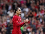 Liverpool's Virgil van Dijk applauds the fans as he is substituted on August 8, 2021