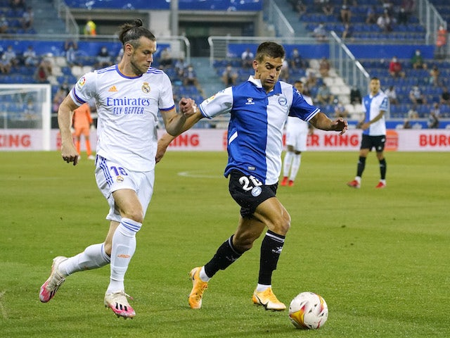 Real Madrid's Gareth Bale in action with Deportivo Alaves' Pere Pons in La Liga on August 14, 2021