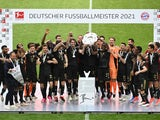 Bayern Munich celebrate with the trophy after winning the Bundesliga on May 22, 2021