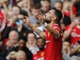 Manchester United's Bruno Fernandes celebrates scoring against Leeds United in the Premier League on August 14, 2021