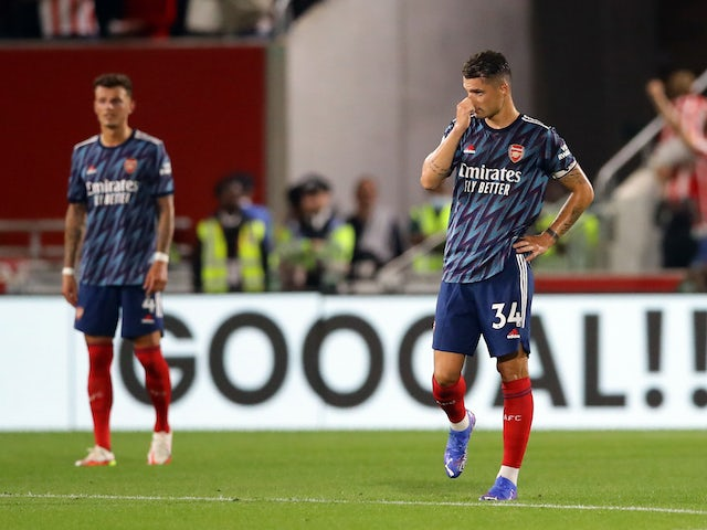 Arsenal's Granit Xhaka and Ben White look dejected after Brentford's Christian Norgaard scored their second goal on August 13, 2021