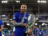 An injured Hakim Ziyech celebrates after Chelsea win the UEFA Super Cup on August 11, 2021
