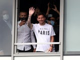 Lionel Messi waves as he arrives in Paris pictured on August 10, 2021