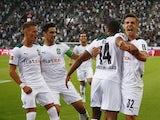 Borussia Monchengladbach's Alassane Plea celebrates scoring their first goal with teammates on August 13, 2021