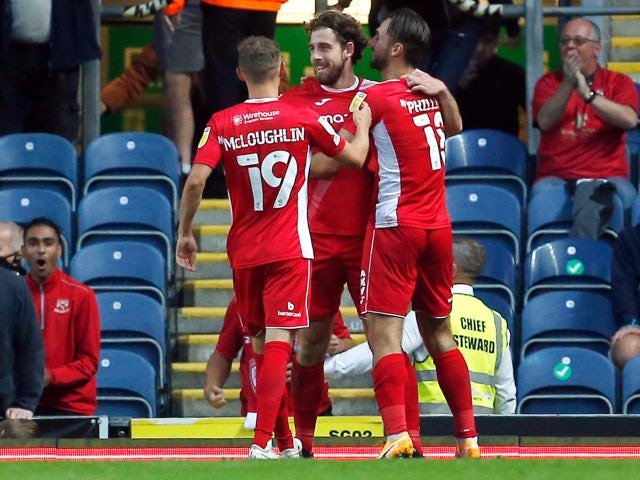 Morecambe's Cole Stockton celebrates scoring their first goal against Blackburn Rovers in the EFL Cup on August 10, 2021