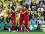 Liverpool's Roberto Firmino celebrates scoring against Norwich City in the Premier League on August 14, 2021