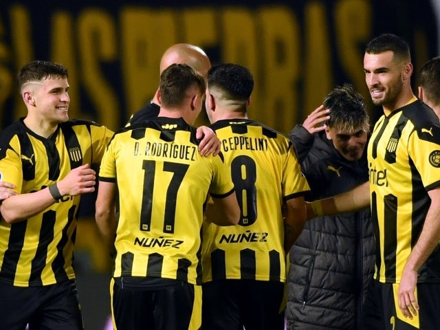 Penarol players celebrate after the match against Nacional on July 22, 2021