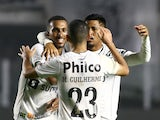 Santos' Lucas Braga celebrates with teammates after an own goal scored by Libertad and Santos' second on August 13, 2021