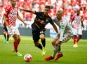RB Leipzig's Andre Silva in action with Mainz 05's Robin Zentner on August 15, 2021
