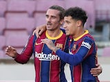 Barcelona's Philippe Coutinho celebrates with Antoine Griezmann on November 29, 2020
