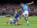 Barcelona's Eric Garcia in action with Real Sociedad's Aihen Munoz on August 15, 2021