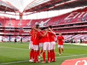 Benfica's Pizzi celebrates with teammates on May 15, 2021