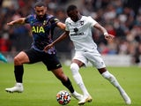 MK Dons striker Mohamed Eisa in action with Tottenham Hotspur's Cameron Carter-Vickers on July 28, 2021