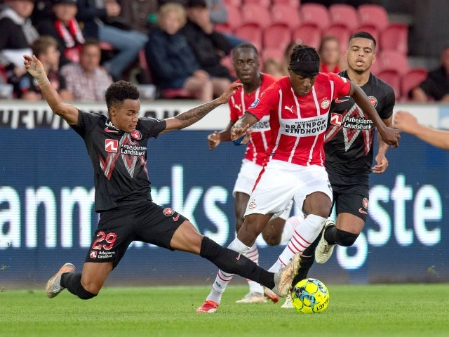 PSV Eindhoven's Noni Madueke in action with FC Midtjylland's Paulinho on August 10, 2021