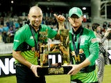 Southern Brave's Alex Davies and Jake Lintott celebrate with the trophy after winning The Hundred Final on August 21, 2021