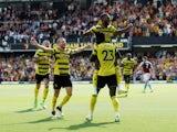 Watford's Emmanuel Dennis celebrates scoring on his debut against Aston Villa on August 14, 2021