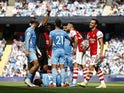 Arsenal's Granit Xhaka is shown a red card by referee Martin Atkinson on August 28, 2021