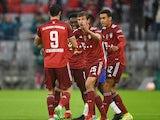 Bayern Munich's Thomas Muller celebrates scoring their first goal with Robert Lewandowski on August 28, 2021